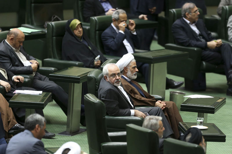 Iranian Foreign Minister Mohammad Javad Zarif (centre), who is also Iran's top nuclear negotiator sits while listening to the speech of President Hassan Rouhani in an open session of parliament in Tehran, Iran, on Sunday, January 17, 2016. Photo: AP