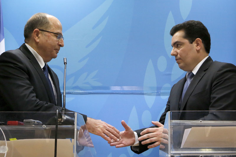 Israeli Defence minister Moshe Yaalon (left), and his Cypriot counterpart Fotis Fotiou shake hands during their statements to the media after their meeting at the Defence ministry in capital Nicosia, Cyprus, on Wednesday, February 24, 2016. Photo: AP