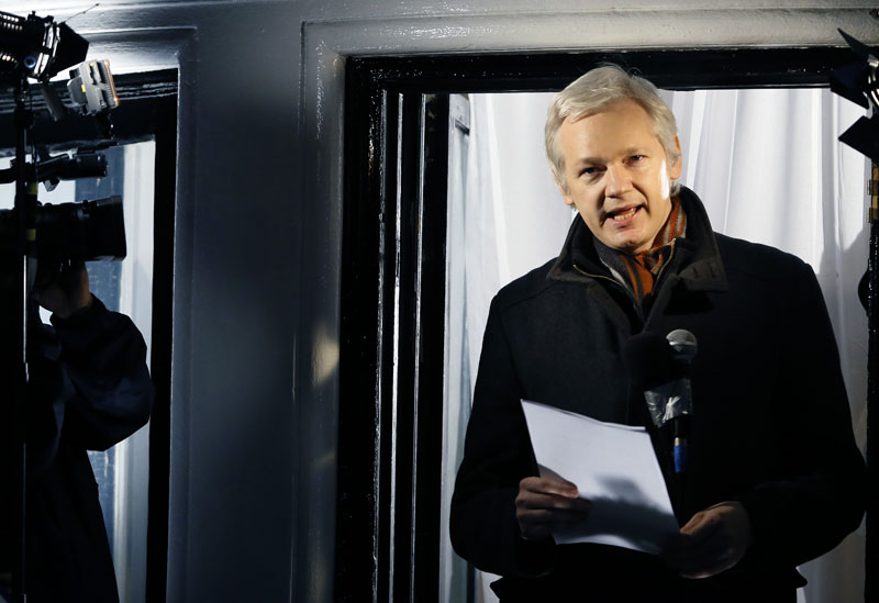 FILE - Julian Assange, founder of WikiLeaks speaks to the media and members of the public from a balcony at the Ecuadorian Embassy in London, on Thursday, December 20, 2012. Photo: AP