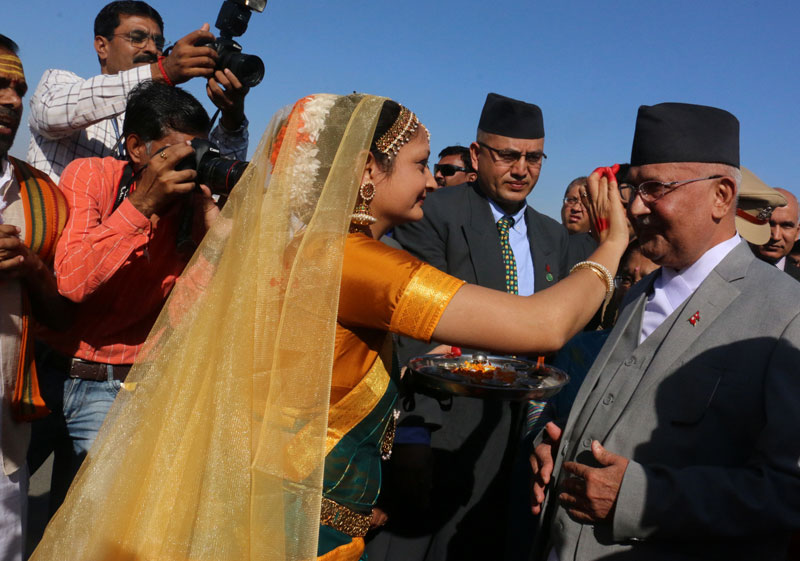 A woman putting tika to Prime Minister KP Sharma Oli at the Bhuj Airport in Gujarat on Tuesday, February 23, 2016. Photo: RSS