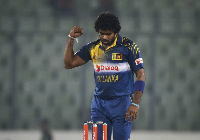 Sri Lanka skipper Lasith Malinga ncelebrates after dismissing United Arab Emiratesu0092 Mohammad Naveed during their Asia Cup T20 match in Mirpur on Thursday. Photo: AP
