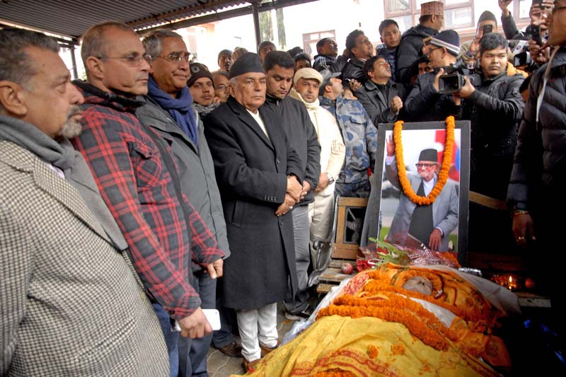 Leaders of the Nepali Congress (NC) huddle around the body of Nepali Congress President and former Prime Minister Sushil Koirala to pay their tributes at Maharajgunj, on Tuesday, February 9, 2016. Photo: Bal Krishna Thapa/ THT