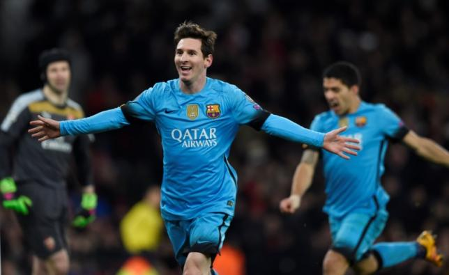 Lionel Messi celebrates scoring the second goal for Barcelona nReuters / Toby MelvillenLivepic