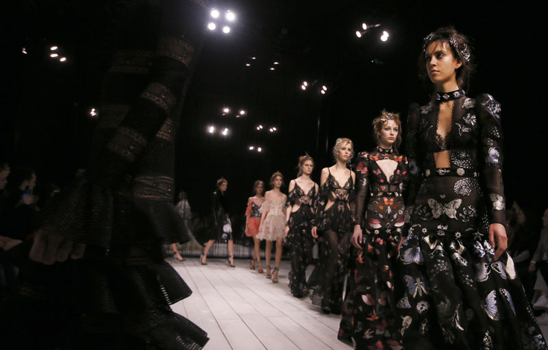 Models display designs during the Alexander McQueen Autumn/Winter show at London Fashion Week, on Sunday, February 21, 2016. Photo: AP