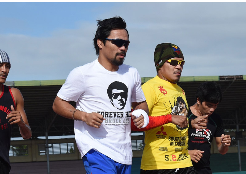 Philippine boxing icon Manny Pacquiao (left) jogging with fellow boxers during a training, in General Santos, on Tuesday. Photo: Reuters