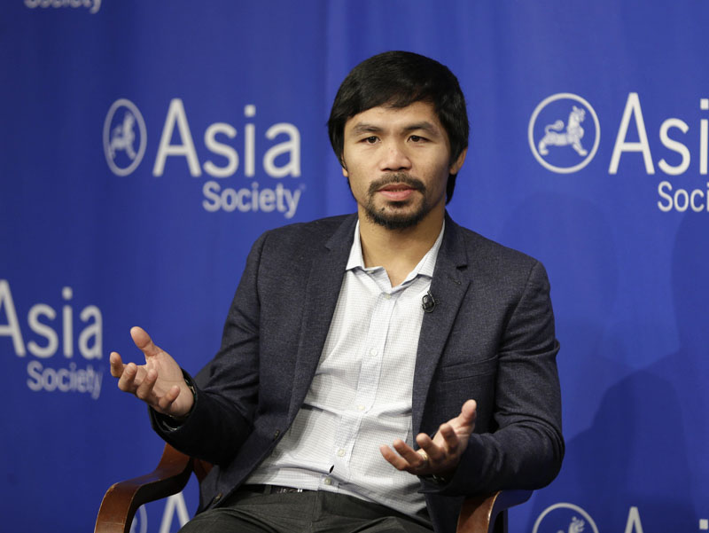 FILE - Manny Pacquiao takes questions at the Asia Society in New York, on October 12, 2015. Photo: AP