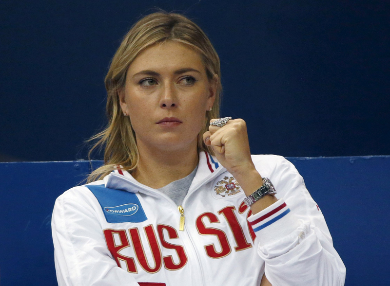 Russia's Maria Sharapova reacts as she watches compatriot Ekaterina Makarova play against Kiki Bertens of the Netherlands during their Fed Cup World Group tennis match in Moscow, February 6, 2016. Photo: Reuters