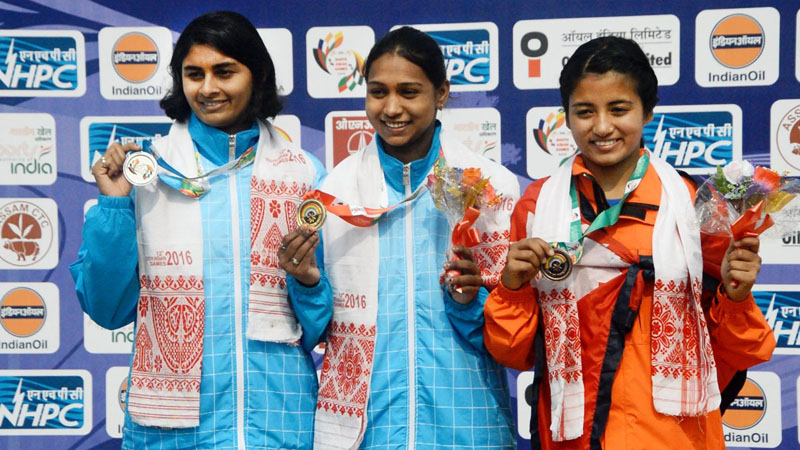 Nepal's Roja KC (right) holds the bronze medal with her Indian counterparts after their individual category of triathlon event at the Dr Zakir Hussein Aquatics Stadium, in Guwahati, on Saturday. Photo Courtesy: SA Games' twitter