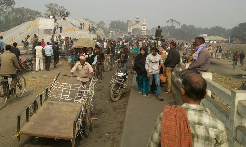 Movement of people at the Nepal-India border point in Birgunj after some local traders burn down tents set by protesters, on Friday, February 5, 2016. Photo: Ram Sarraf