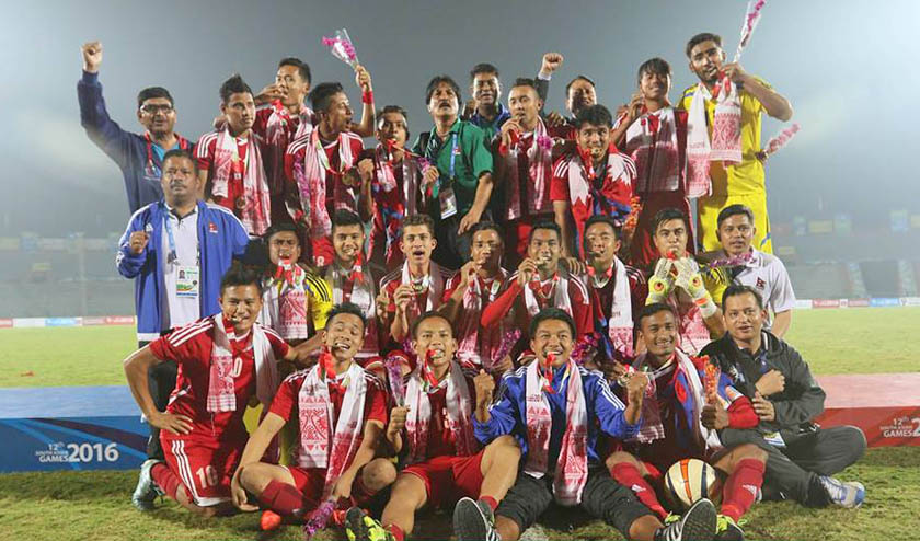 Nepali players pose for photograph after  winning gold medal in SAG men's football defeating India 2-1 in Guwahati on Monday evening. Photo: ANFA