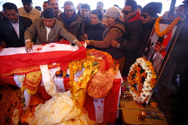 Nepali Congress leaders lay the party flag on Sushil Koirala in Sanepa