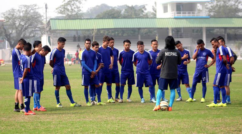 Nepal national team coach Raju Kaji Shakya giving lessons to players during a training session in Guwahati on Saturday, February 6, 2016. Photo: Courtesy ANFA