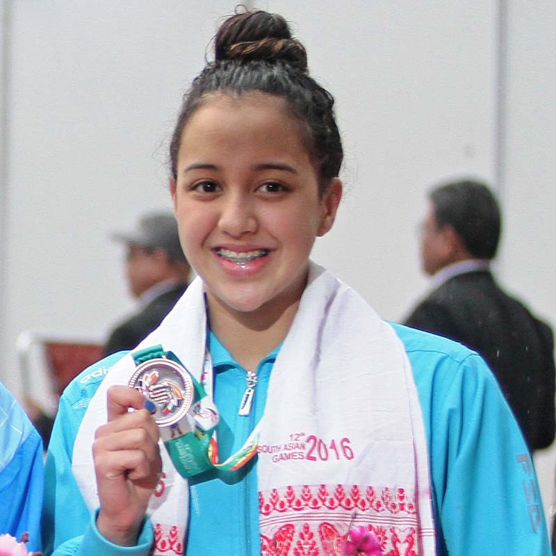 Nepali swimmer Gaurika Singh holds her bronze medal in the 12th South Asian Games at the Dr Zakir Hussain Aquatics Complex in Guwahati on Tuesday, February 9, 2016.