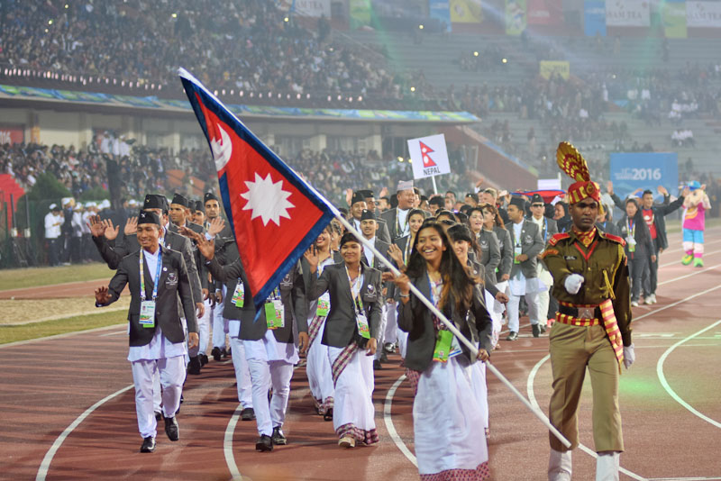 Nepal's swimmer Shreetika Singh leading the Nepali team in the march past during the opening ceremony of the 12th South Asian Games in Guwahati of India on Friday, February 05, 2016.