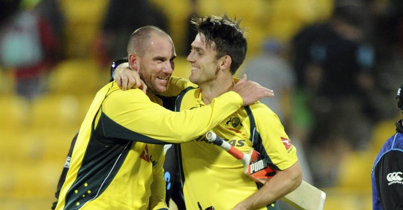 Australia's John Hastings (left) and teammate Mitchell Marsh celebrate their team's victory over New Zealand in the second ODI match at Westpac Stadium in Wellington on Saturday. Photo: AP