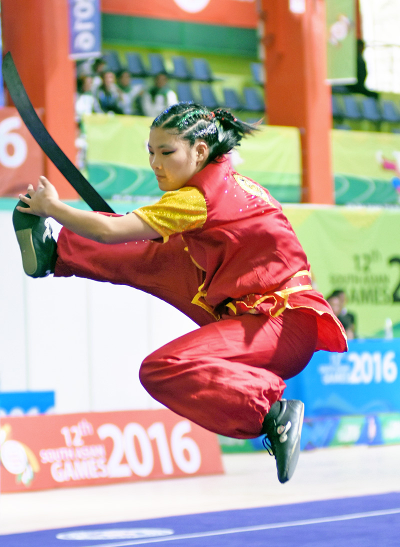Nima Gharti Magar, who won the first gold medal for Nepal in wushu's NanQuan event in the 12th South Asian Games, in Shillong, on Monday, February 8, 2016. Courtesy: Photojournalist Club