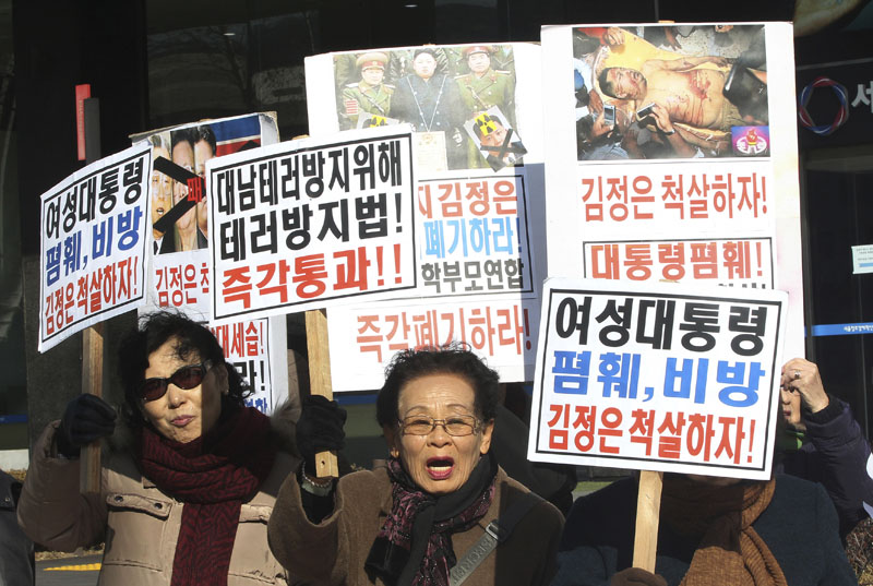 North Korean defectors shout slogans during a rally to denounce North Korea's criticism of South Korean President Park Geun-hye in Seoul, South Korea, on February 23, Tuesday, 2016. Photo: AP