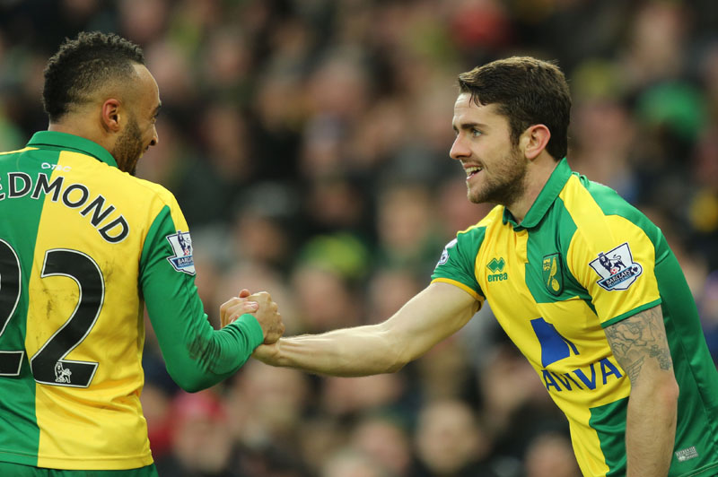 Norwich City's Robbie Brady (right) celebrates scoring against West Ham United with teammate Nathan Redmond during the English Premier League soccer match at Carrow Road, Norwich, England, on Saturday, February 13, 2016. Photo: Chris Radburn/PA via AP