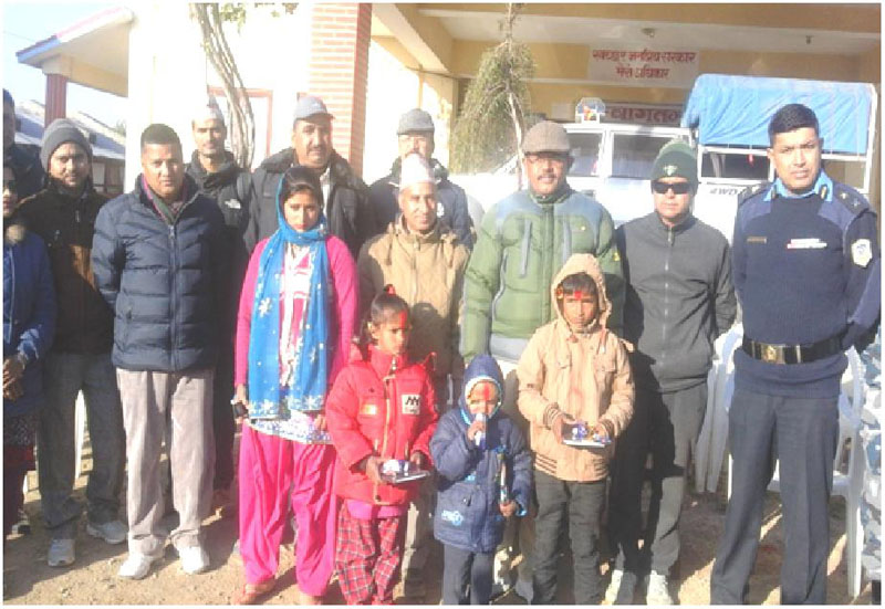 Orphaned siblings posing for a photo with Chief District Officer of Kailali,  Prem Prasad Luintel (third from right), in Kailali, on Sunday. Photo: THT