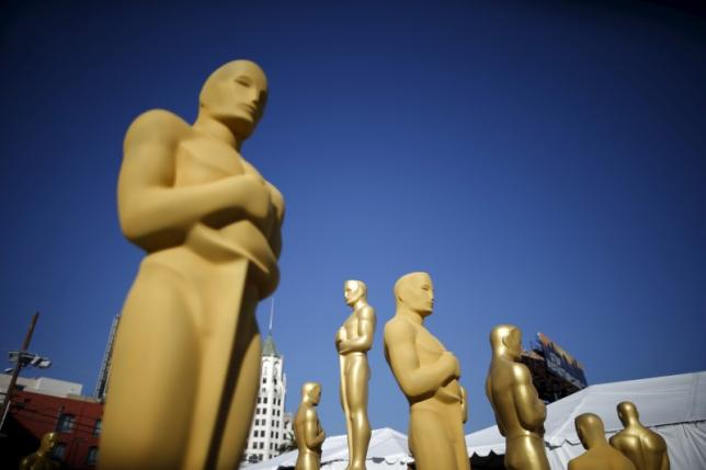 Oscar statues are painted outside the entrance to the Dolby Theatre as preparations continue for the 88th Academy Awards in Hollywood, Los Angeles, California in this February 25, 2016 file photo.  REUTERS/Lucy Nicholson