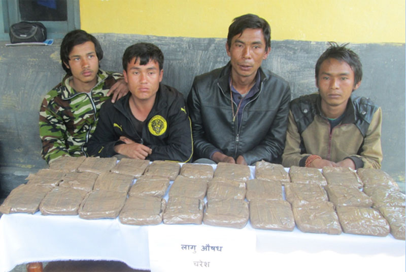 Police making public four persons arrested with 15 kg hashish on Thursday, February 18, 2016. Photo: Rishi Ram Baral n