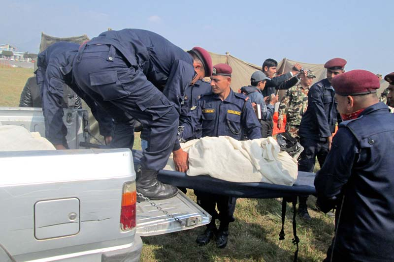 Police personnel carry bodies of the deceased passengers of the Tara Air plane, which crashed in Dana VDC of Myagdi on its way to Jomsom from Pokhara yesterday, at the Pokhara Airport, on Thursday, February 25, 2016. Photo: Rishi Ram Baral/ THT