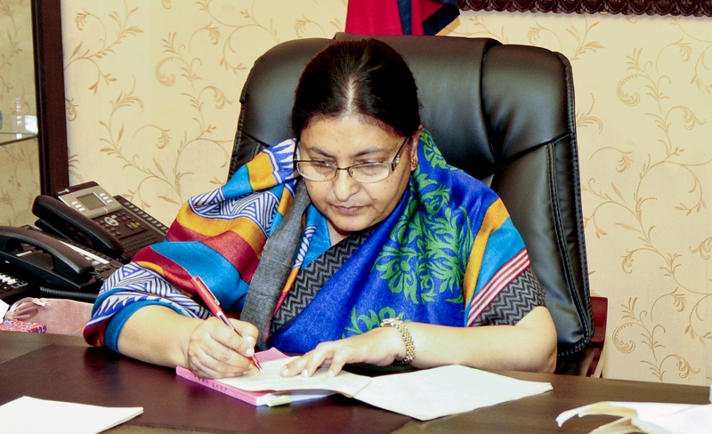 President Bidya Devi Bhandari signs to enact a bill at the Sheetal Niwas, on Thursday, February 25, 2016. Photo: President's Office