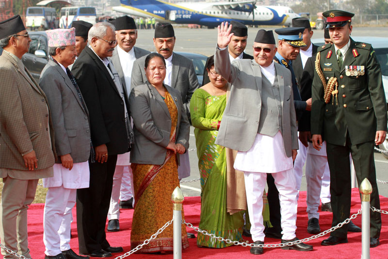 Prime Minister KP Sharma Oli waves to mediapersons before he leaves for New Delhi of India on Friday, February 19, 2016. Photo: RSS