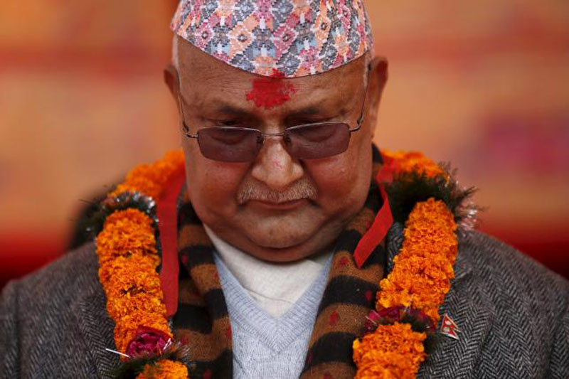 Nepal's Prime Minister Khadga Prasad Sharma Oli, also known as KP Oli, observes a minute of silence for earthquake victims during an event organised to mark the 18th National Earthquake Safety Day and the official launch of earthquake reconstruction efforts in Bungamati. Photo: Reuters
