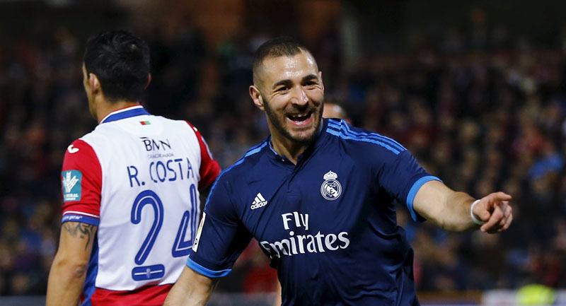 Real Madrid's Karim Benzema celebrates after scoring a goal against Granada during their Spanish League match  at Los Carmenes Stadium, in Granada, on Sunday. Real won 2-1. Photo: Reuters