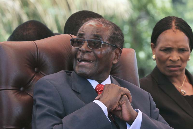Zimbabwe's President Robert Mugabe laughs before addressing the ZANU-PF party's top decision making body, the Politburo, in the capital Harare, on February 10, 2016. Photo: Reuters
