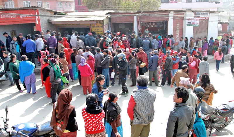 Locals queuing up in line to get kerosene from an oil store in Ratopool, Kathmandu on Tuesday, February 2, 2016. Photo: RSS