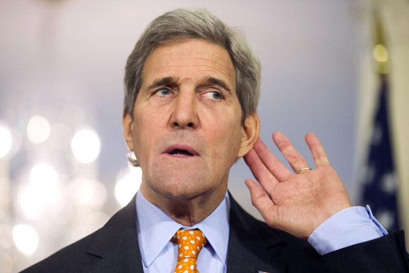 FILE - Secretary of State John Kerry puts his hand to his ear while listening to a reporter's question at the State Department in Washington, on February 17, 2016.  Photo: AP