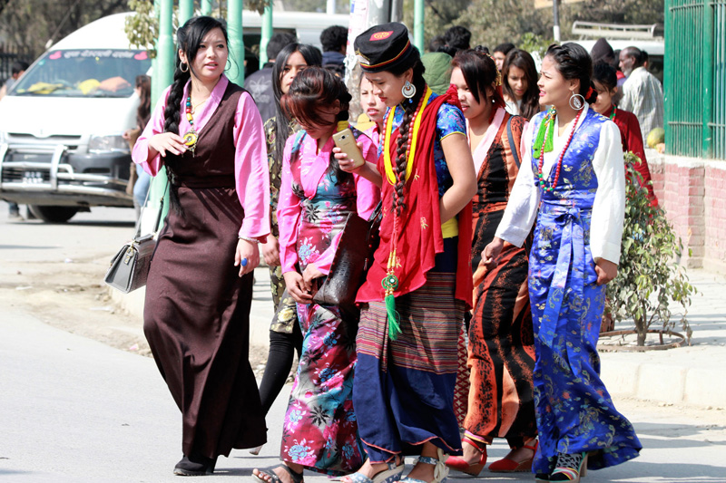 Girls dressed in traditional attires walk towards Tudikhel to observe the Sonam Lhosar in Kathmandu on Tuesday, February 9, 2016. Photo: RSS