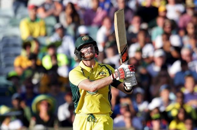 Australia's Steve Smith watches the ball after he hit it for a six during their One Day International cricket match against India in Perth January 12, 2016. REUTERS/Bill Hatto