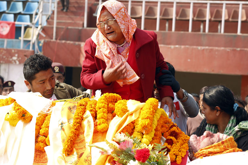 A woman pays final tribute to Sushil Koirala at the Dasharath Stadium, on Wednesday, February 10, 2016. Photo: RSS