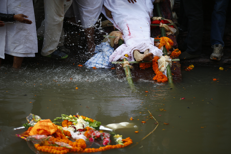 Feet of late Sushil Koirala seen as priests perform his final rites at the Pashupati Aryaghat, in Kathmandu, on Wednesday, February 10, 2016. Photo: Skanda Gautam