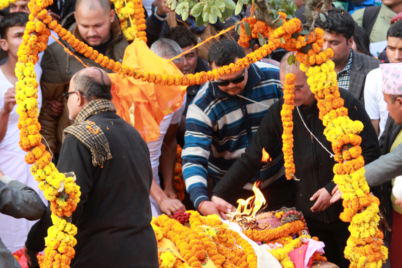 Nephews of former Prime Minister Sushil Koirala light the leader's funeral pyre at the Pashupati Aryaghat, in Kathmandu, on Wednesday, February 10, 2016. Photo: RSS
