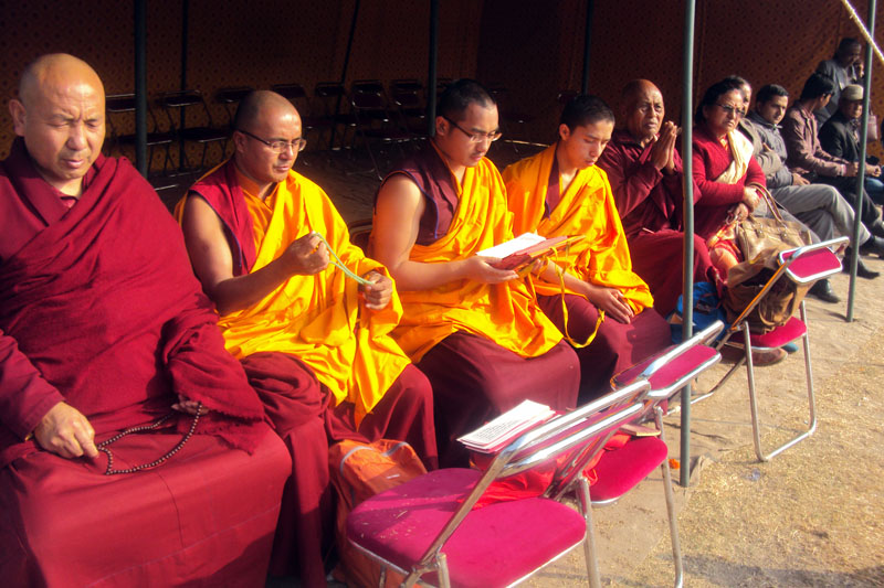 Buddhist monks recite religious texts at Dasharath Stadium before Sushil Koirala's funeral process began. Photo: RSS