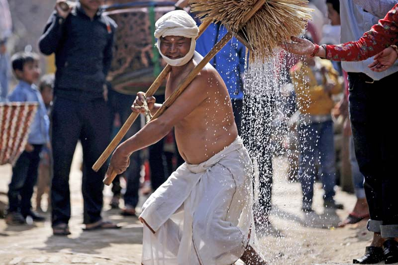 A devotee performs religious rituals during the Swasthani Bratakatha festival at Thecho in Lalitpur, Nepal, on February 19, 2016. Devotees go on pilgrimages to various temples, perform religious rituals, take a holy bath in the rivers and fast, especially among women who believe fasting helps in their family's well-being or in getting them a good husband, in the month-long festival. Photo: Reuters