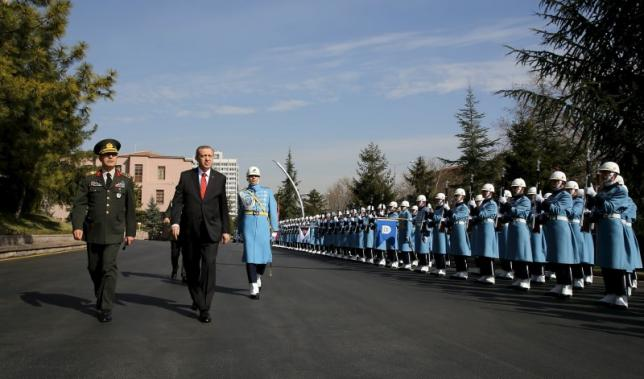 Turkish President Tayyip Erdogan (2nd L), flanked by Chief of Staff General Hulusi Akar, reviews a guard of honour as he arrives the Army headquarters in Ankara, Turkey February 18, 2016, in this handout photo provided by the Presidential Palace. REUTERS/Yasin Bulbul/Presidential Palace/Handout via Reuters
