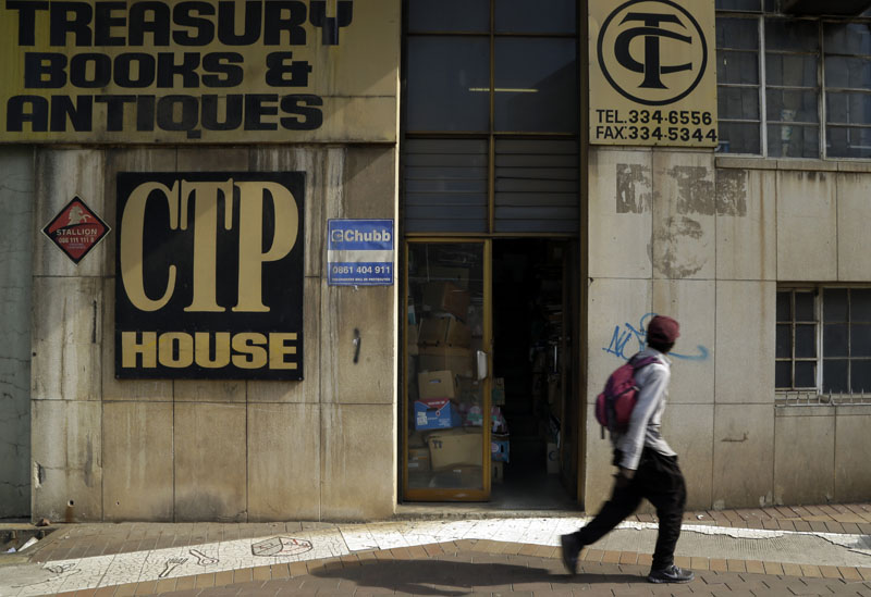 A pedestrian passes the Coolectors Treasury in Johannesburg, South Africa on Monday, February 8, 2016. Photo: AP