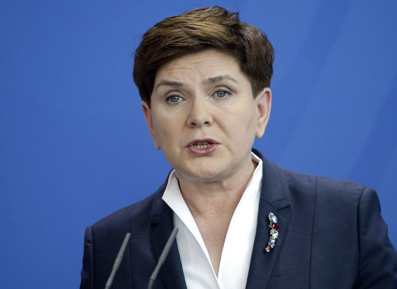 The Prime Minister of Poland, Beata Szydlo, speaks during a joint news conference with German Chancellor Angela Merkel as part of a meeting at the chancellery in Berlin, Germany, Friday, Feb. 12, 2016. (AP Photo/Michael Sohn)