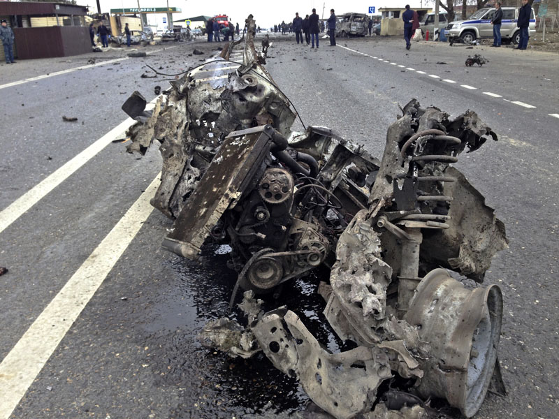 The wreckage of a suicide bomber car is seen near a traffic police check point near a village of Dzhemikent in Russian northern Caucasus region of Dagestan on Monday, February 15, 2016. Photo: Bashir Aliev/ NewsTeam photo via AP