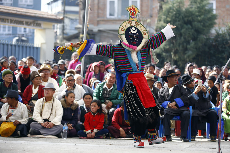 A Tibetan masked person performs a traditional dance during an occasion to mark Losar or Tibetan New Year, at Bhirkuti School in Boudha, Kathmandu on Thursday. A minor number of exiled Tibetans assembled at the school compound to celebrate the New Year. Photo/Skanda Gautam