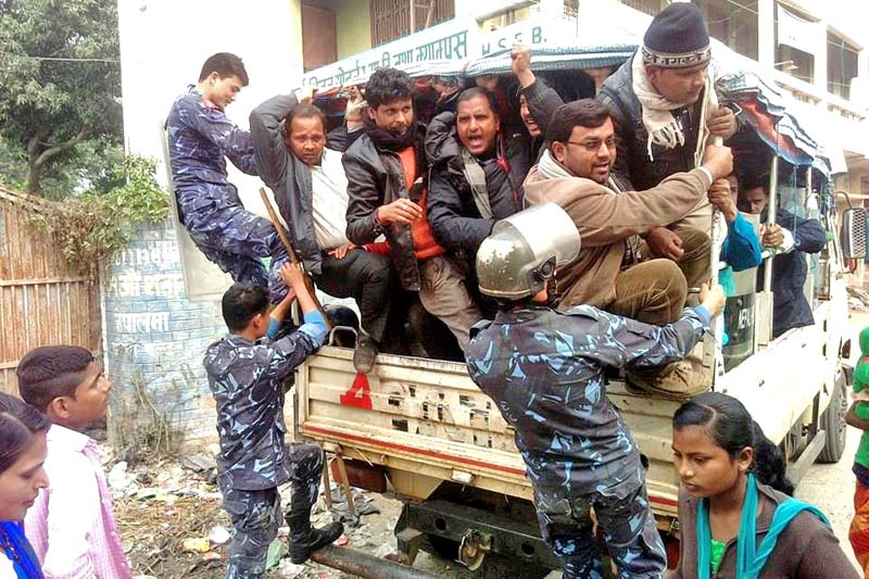 Police detaining cadres of United Democratic Madhesi Front for trying to foil the Nepali Congress' municipal convention, in Rajbiraj, Saptari, on Tuesday. Photo: THT
