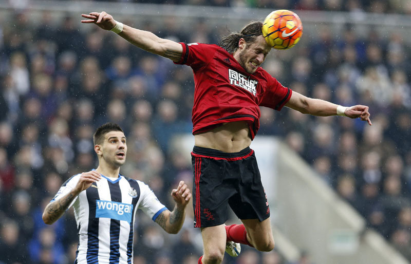 West Bromwich Albion's Jonas Olsson clears the ball , during the English  Premier League soccer match between Newcastle and West Bromwich, at St James' Park, in Newcastle, England, on Saturday February 6, 2016. Photo: Owen Humphreys/PA via AP