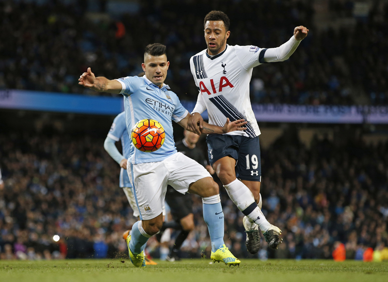 Manchester City's Sergio Aguero in action with  Tottenham's Mousa Dembelen during Barclays Premier League game at Etihad stadium on Sunday, February 14, 2016. Photo: Reuters