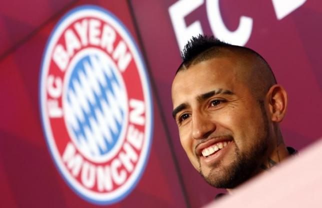 Chile's Arturo Vidal, Bayern Munich's new signing, smiles as he is introduced to the media at the Allianz Arena in Munich, Germany July 28, 2015.  REUTERS/Michaela Rehle