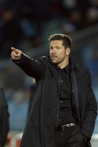Atletico's coach Diego Simeone points during a La Liga soccer match between Atletico de Madrid and Getafe at the Coliseum Alfonso Perez stadium in Madrid, Spain, Sunday, Feb. 14, 2016. AP